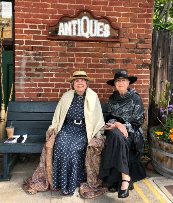 two women in old fashioned clothing